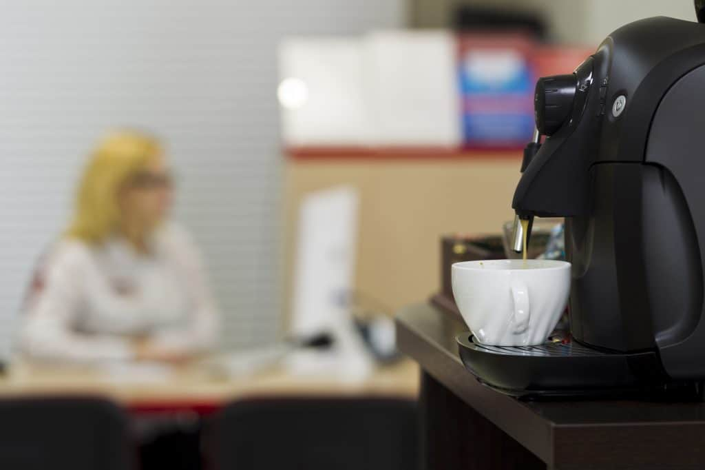a small coffee machine on a table