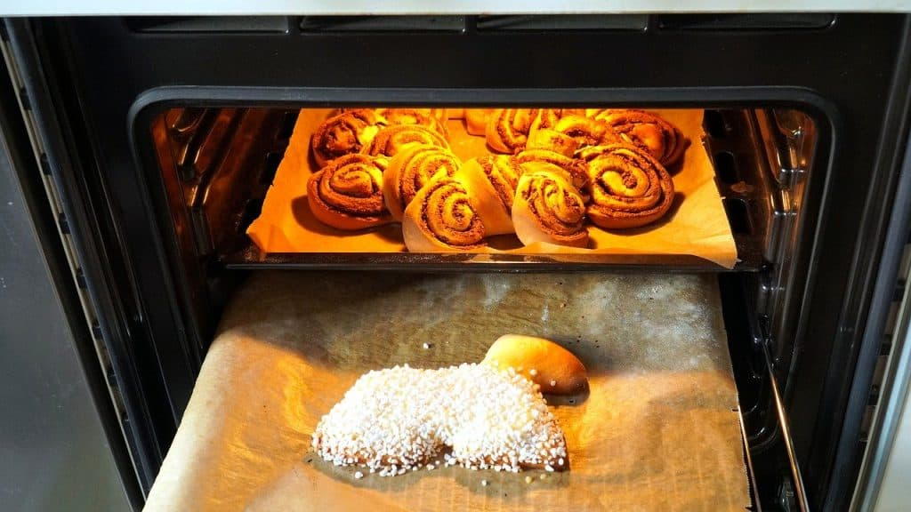cinnamon rolls baking in an electric oven
