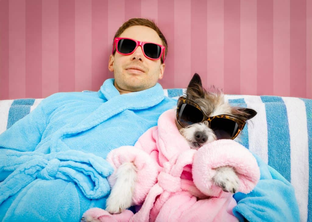 man and his dog, both in a dressing gown with shades