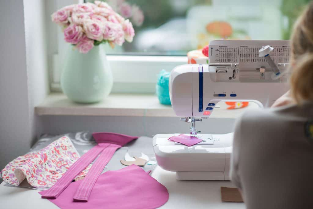 Woman sewing fabric on a machine