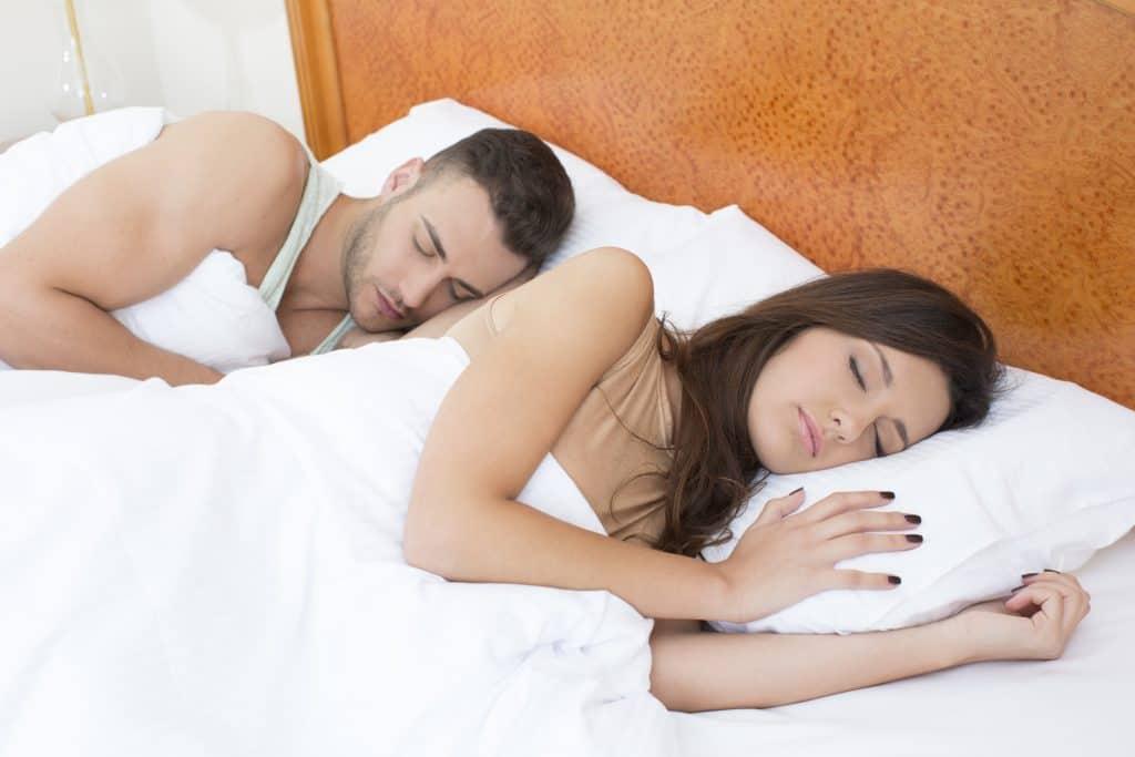 A side sleeping couple