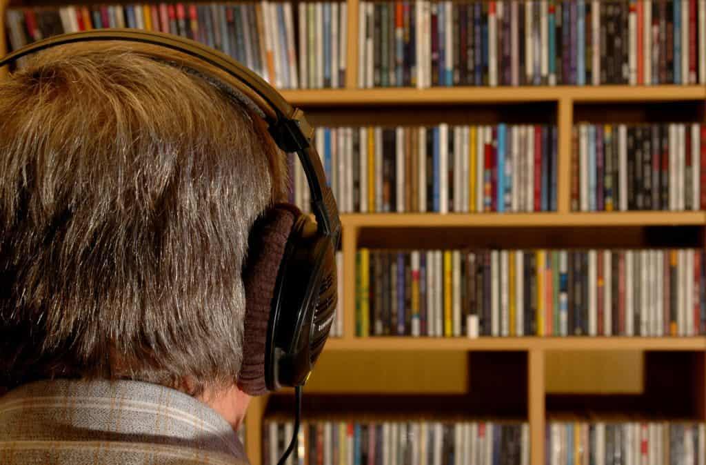 elderly man listening to CDs