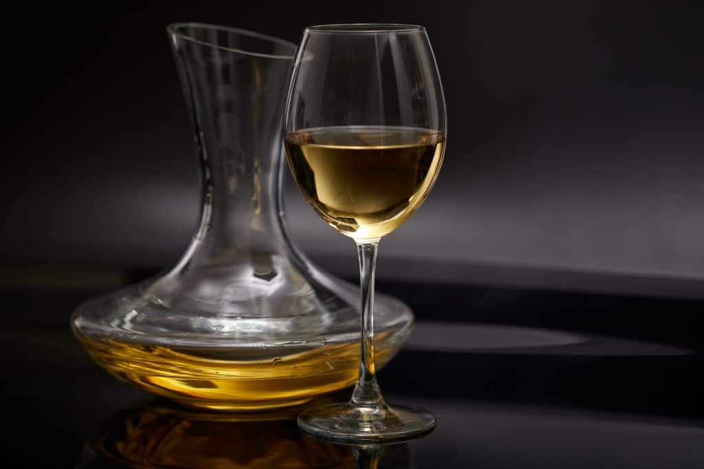 white wine in a decanter and glass