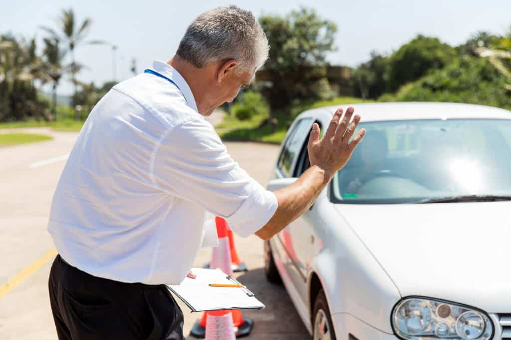 driving instructor stopping a car