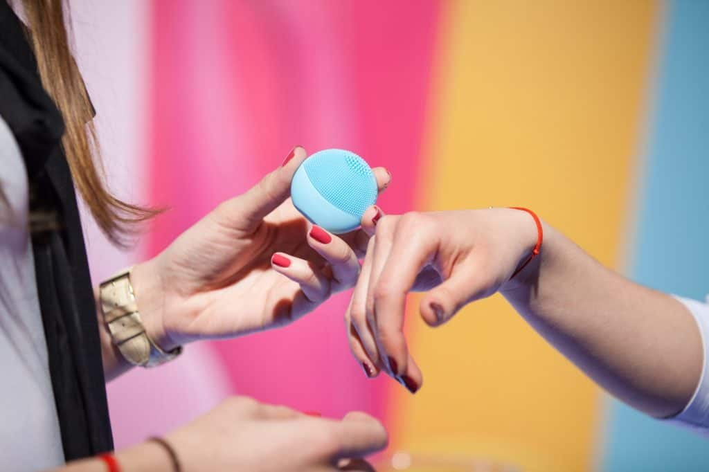 Foreo style brush being used on the hands