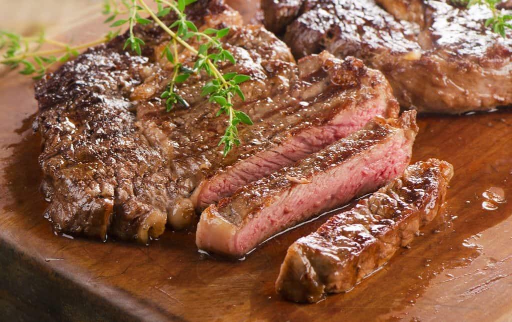 grass-fed beef steak on a wooden board