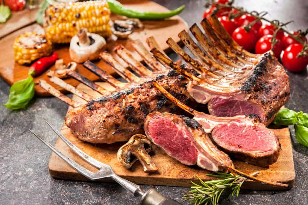 free-range grilled rack of lamb on a cutting board