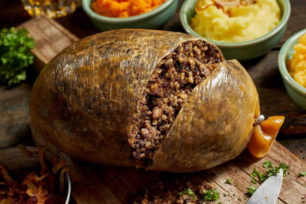 sliced open cooked Scottish haggis on a cutting board