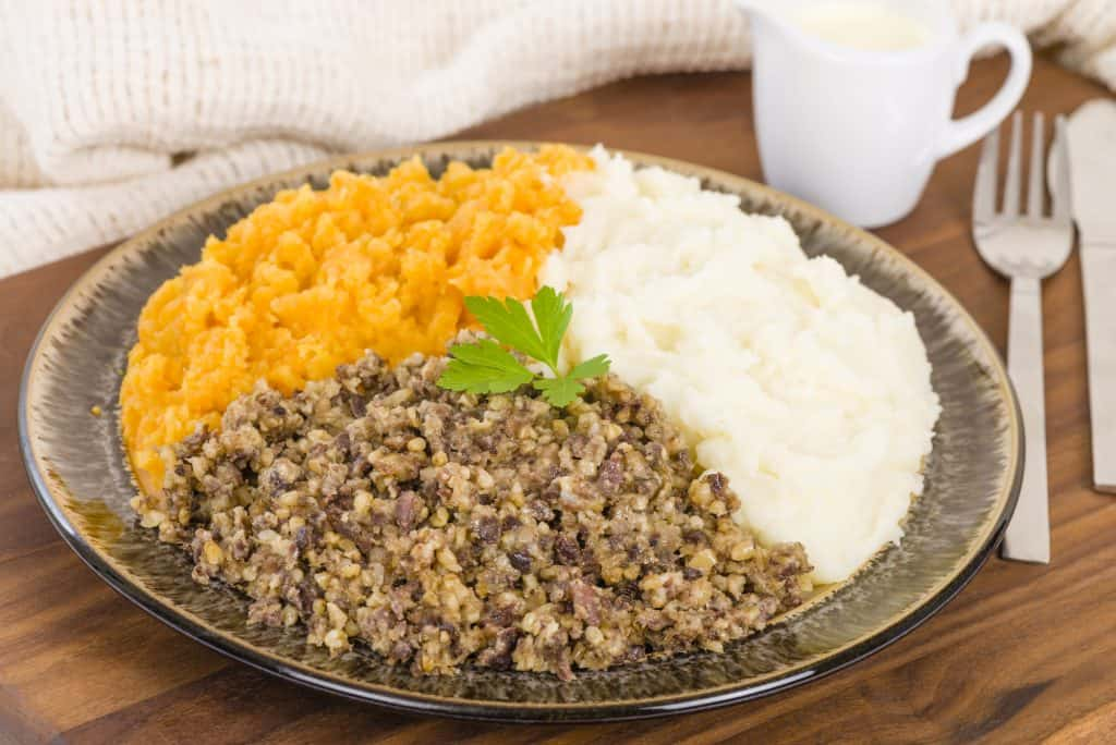 haggis served with neeps and tatties on a plate