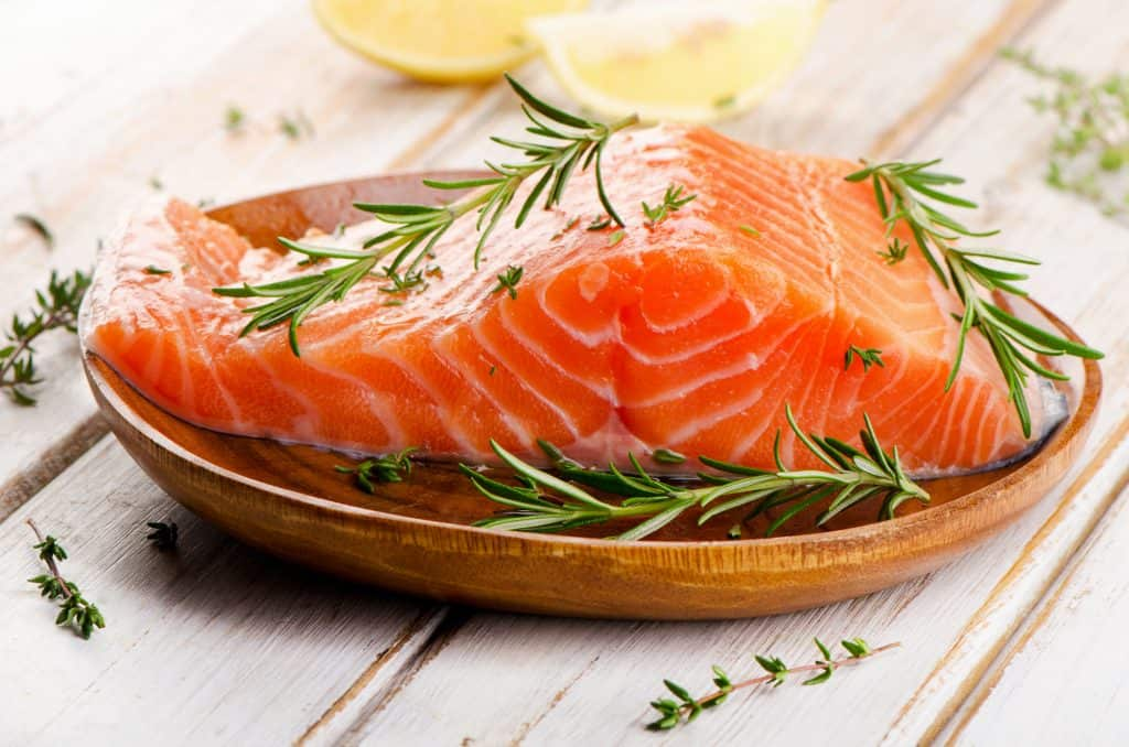 raw salmon fillet on a cutting board