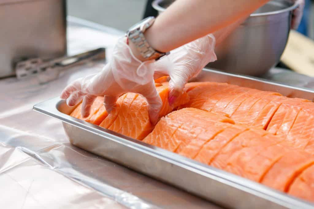fresh sliced salmon in a metal container