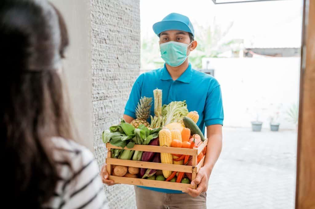man delivering vegetables to customer at home, ordered online